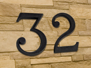 Numero civico in bronzo fuso